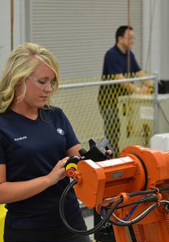 Woman working at machine