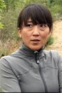 A photograph of an Asian woman