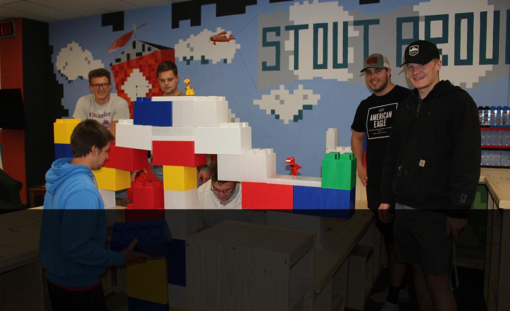 Students building with big legos