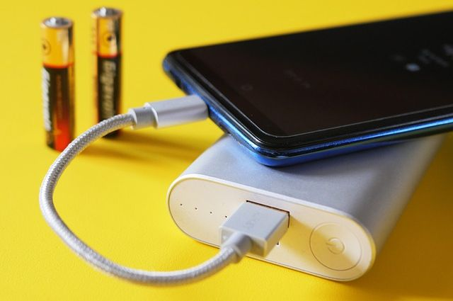 Image of a smartphone plugged into a charger