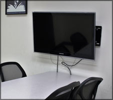 Group study rooms that are located along the back wall of the library