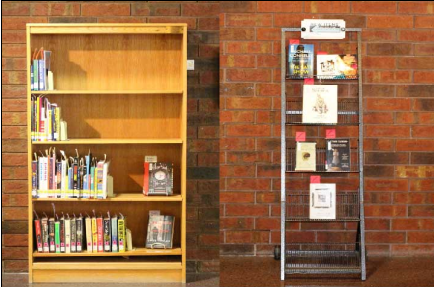 New item shelves located in the lobby of the Library