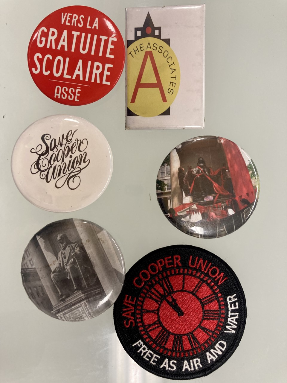 Cooper tuition protest pins