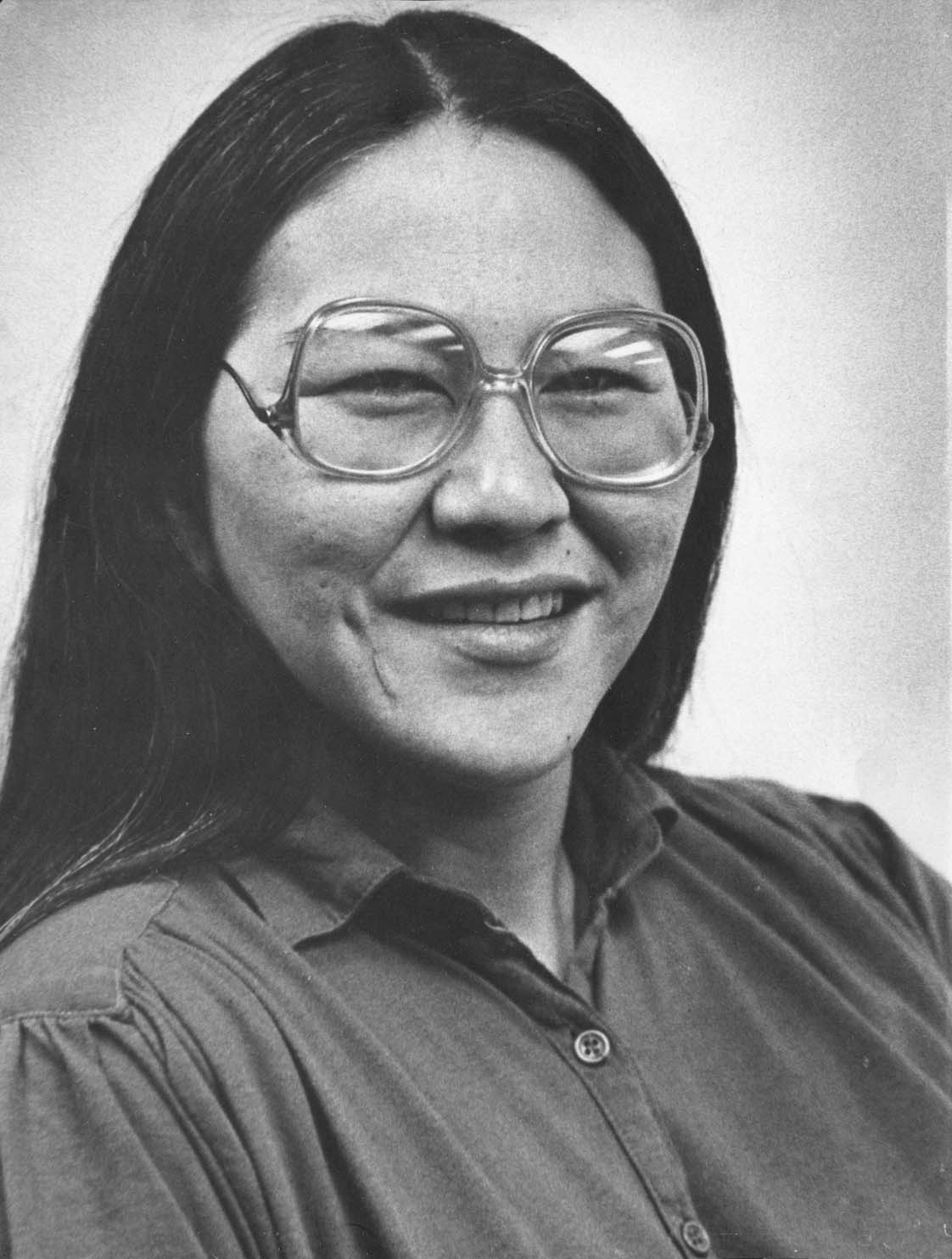 Smiling Native Alaskan woman wearing glasses.