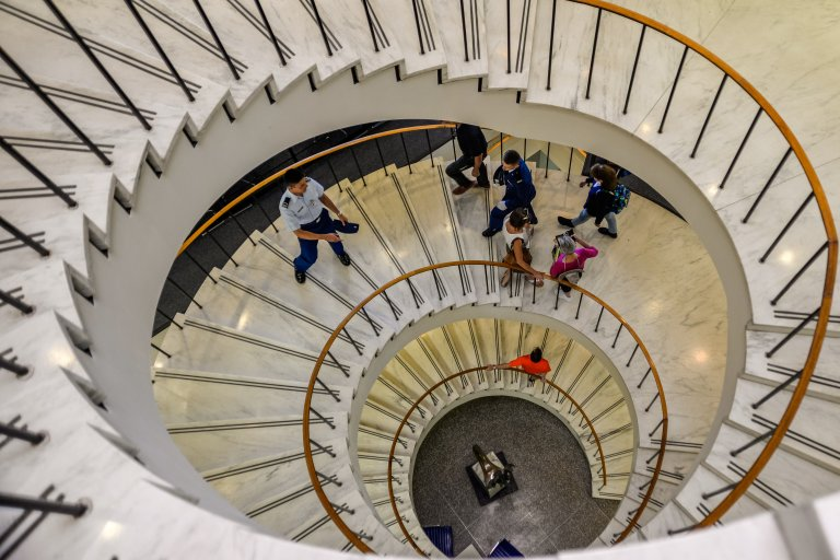 Photo of Cadets on the spiral staircase in McDermott Library