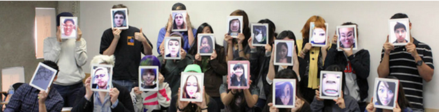 students holding ipads over faces