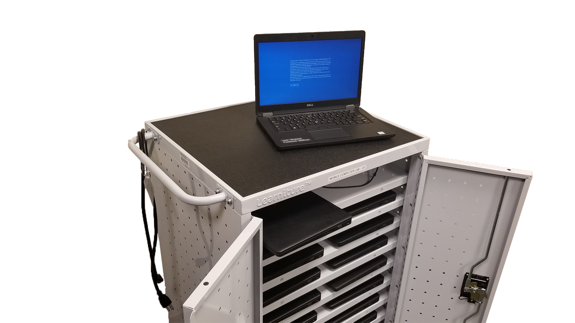 Image of an open laptop on a cart of laptops