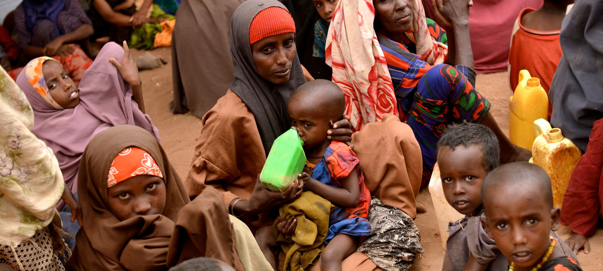Photograph of a mother and her seven children from Somalia in a her seven children in the Hagadera refugee camp in Dadaab, Kenya