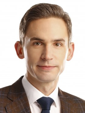 Professional headshot of curator Christopher Maxwell