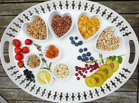 Platter of cereals, nuts, fruits, and herbs.  CC0 from pixabay
