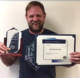 jeff holding plaque and certificate