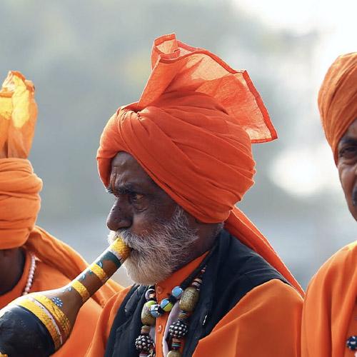 Indian man in orange clothing