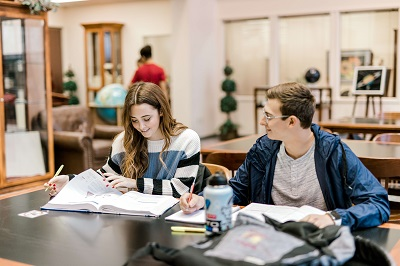 Photo of students studying at a desk