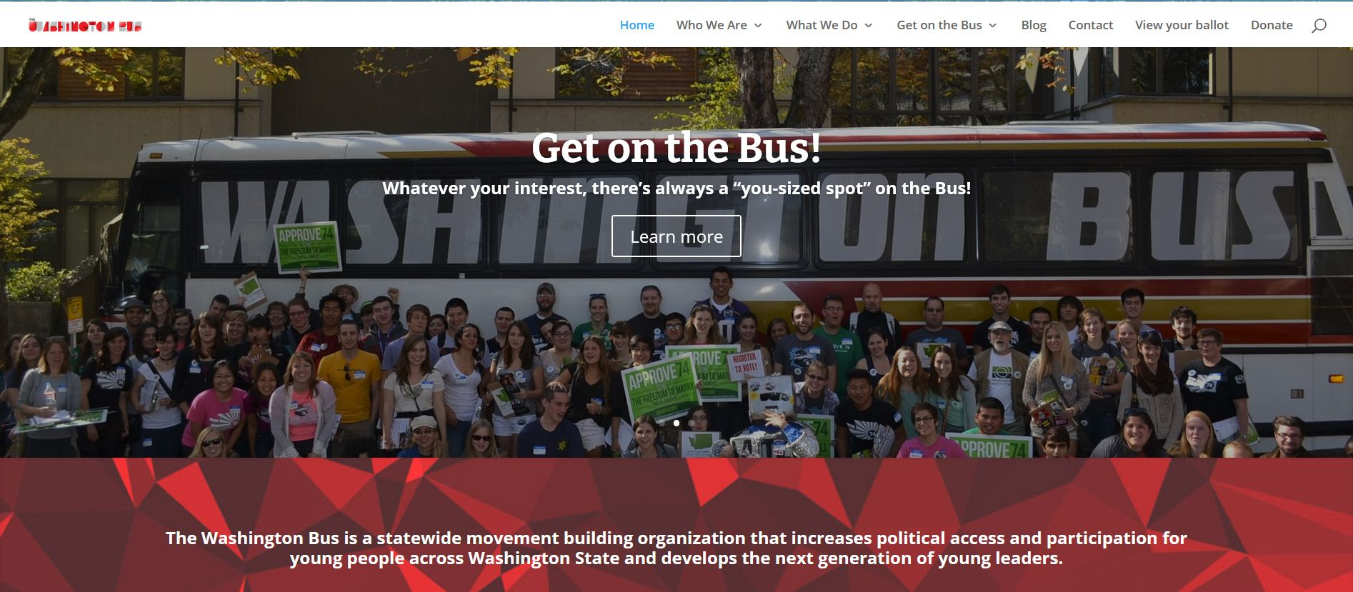 homepage of The Washington Bus with group of people standing in front of a bus holding political signs