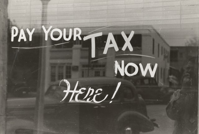 Window that says pay your tax now here