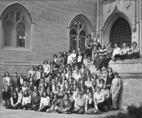 1st female class poses in front of Aquinas Hall
