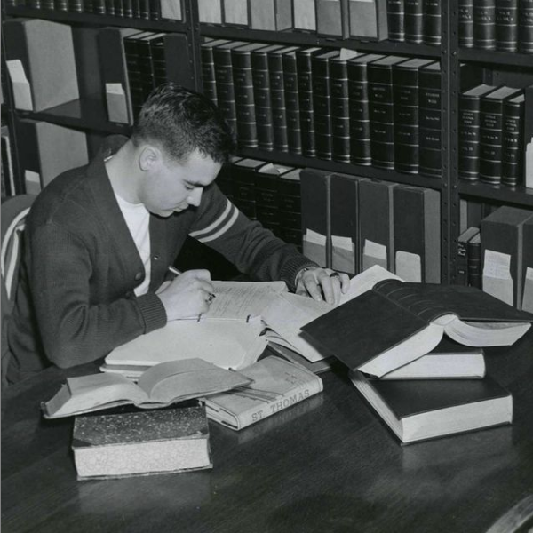 Black and white 1948 photo of student studying