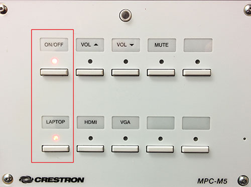 Crestron wall switch with On/Off and Laptop buttons on the left side highlighted.