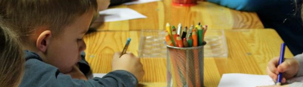 Young kids writing with colored pencils. Click for homepage.
